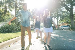 Young Family Walking in Winter Park Neighborhood Orlando Florid